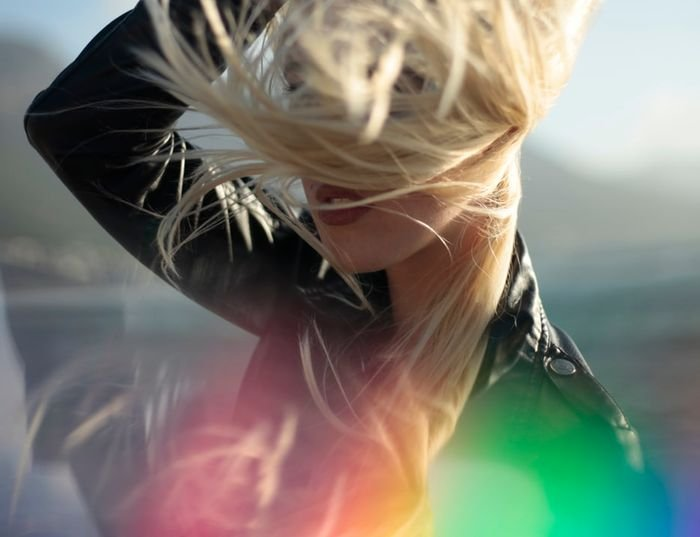 Portrait of a bonde woman with rainbow prism photography effect
