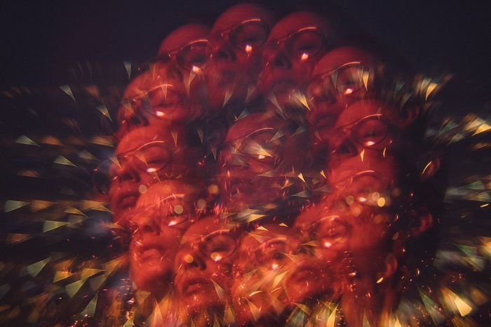 Portrait photo of a woman with kaleidoscope prism photography effect