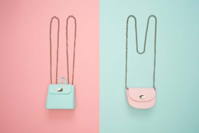 pastel candy coloured shoulder bags on opposite backgrounds, peach pink and mint