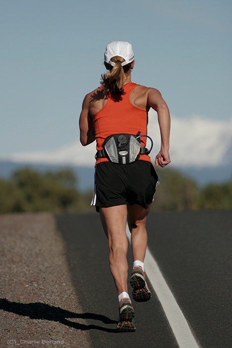 A female jogger running away from the camera - product photography types