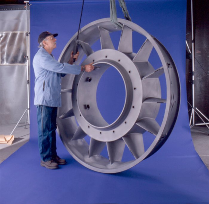A man setting up a product photography photoshoot