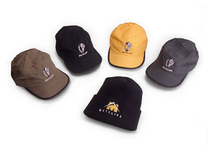 A product photography shoot of 5 different styles of hats against white background