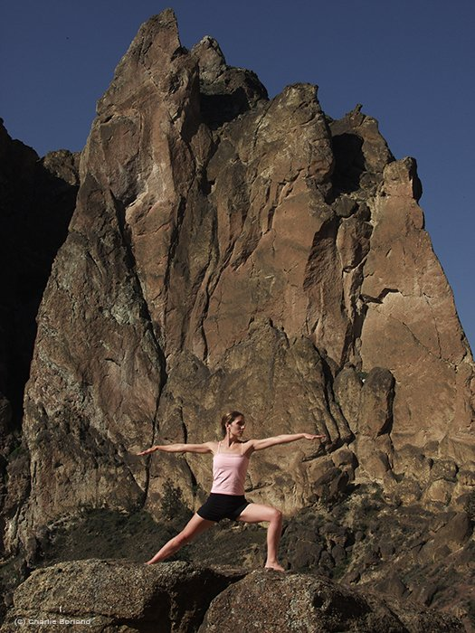 a woman doing yoga poses against a mountainous background - different types of product photography