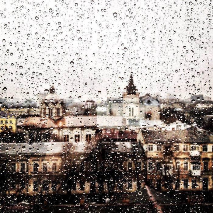 A cityscape seen through a rain splattered window