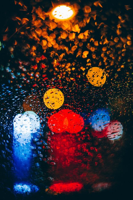 Abstract rain photography shot of coloured bokeh lights