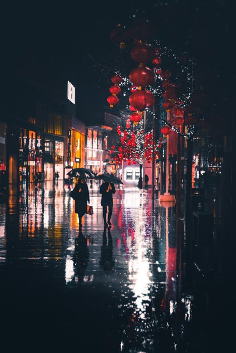 Atmospheric picture of the rain on a city street at night