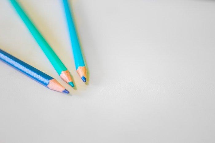 the coloured pencils. dark blue, sky blue, mint
