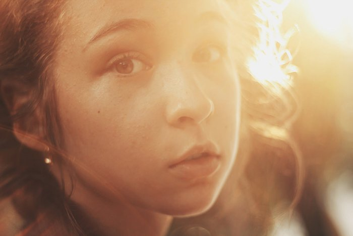Atmospheric portrait of a female model posing outdoors - creative selfie ideas