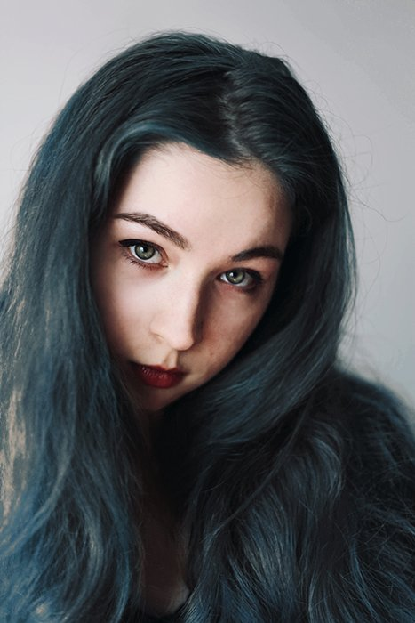 A portrait of a female model with blue hair - great selfie poses