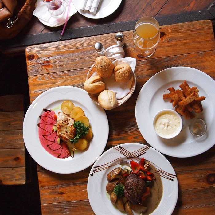 Overhead food photography shot of a lucious looking lunch served on rustic wooden table
