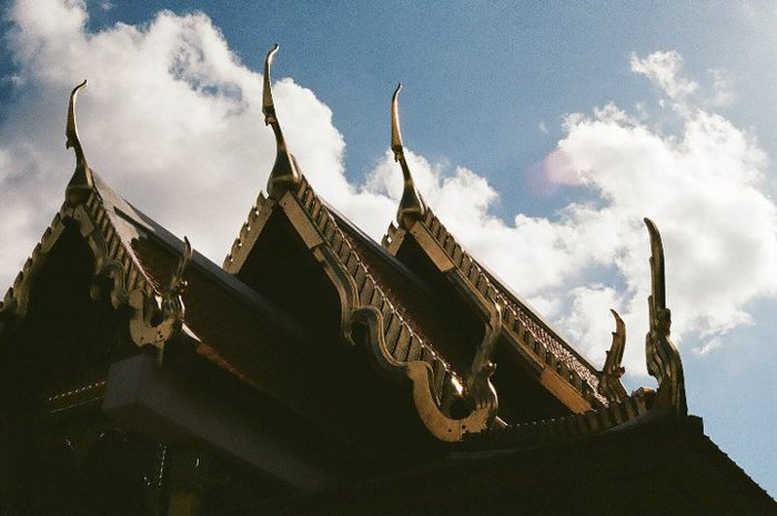 roofs of old asian building against a cloudy afternoon sky - smartphone photography themes