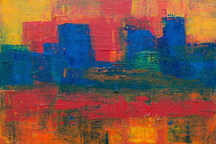 A brightly colored abstract painting with thick impasto texture photography of the paint