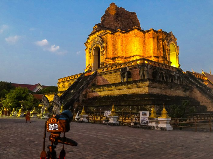 historical architecture in thailand. old temple lit from below, glowing in the dusk - dream photography places