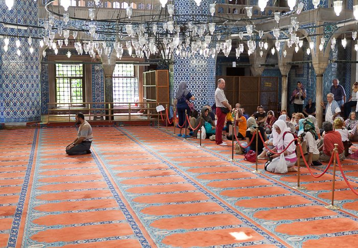 People praying in the Mosque of Rustem Pasa in Istanbul, Turkey