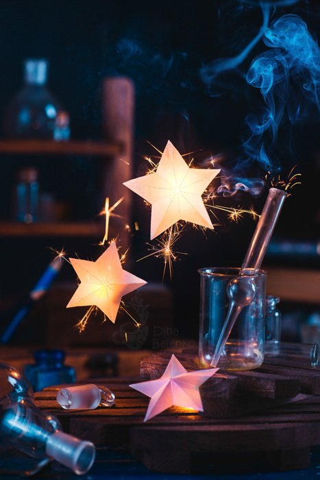 Glowing stars with smoke around them