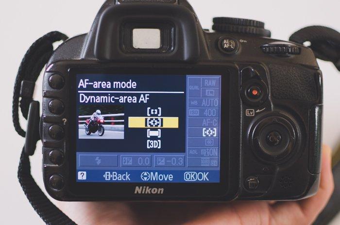The screen of a Nikon DSLR photography camera showing AF-area mode settings - DSLR basics