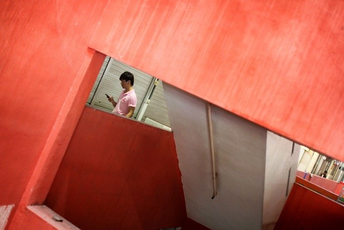 An interesting architecture photography shot of a red interior of a room