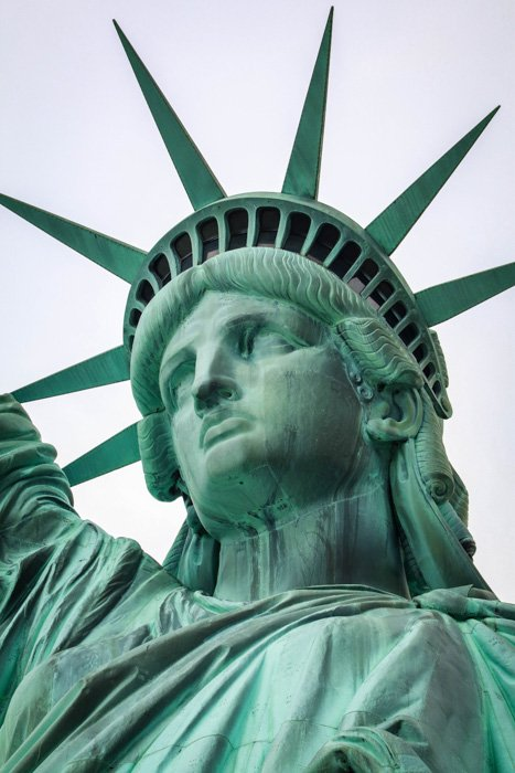 A close up photo of the head of the statue of liberty