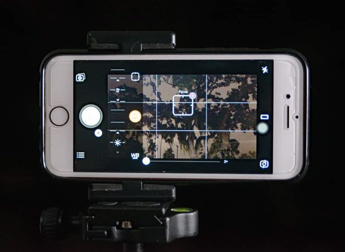 A smartphone set up on a tripod for good lighting