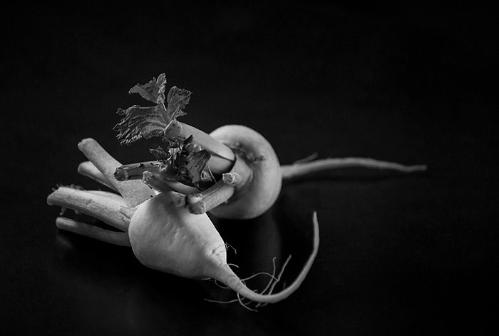 A black and white food still life shot of vegetables