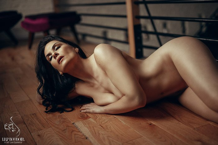 A sensual boudoir shoot of a female model posing nude