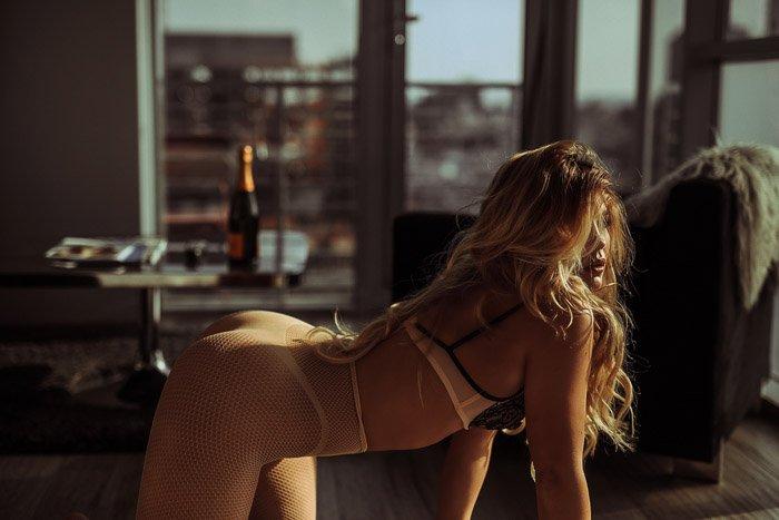 Sensual female model posing in lingerie - boudoir clients