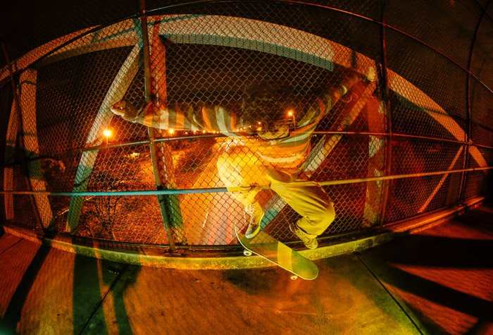 Atmospheric photo of a skateboarder shot using color gel photography