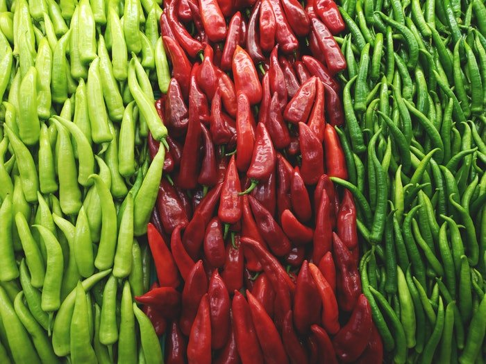 contrasting green and red peppers