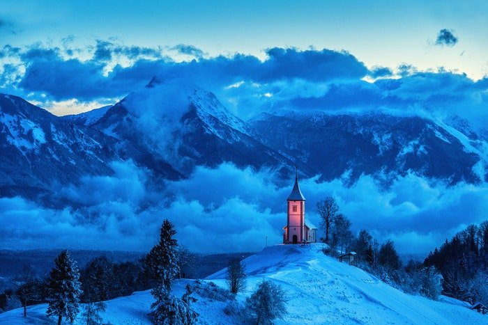 A church lit up in the mountains