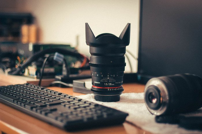A zoom lens on a photographers desk