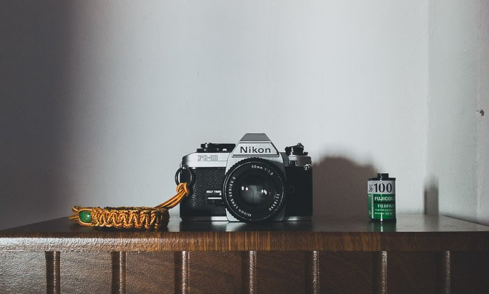 A Nikon camera placed on a shelf
