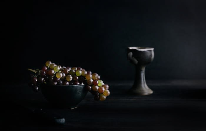 A dark and atmospheric fine art food photography still life