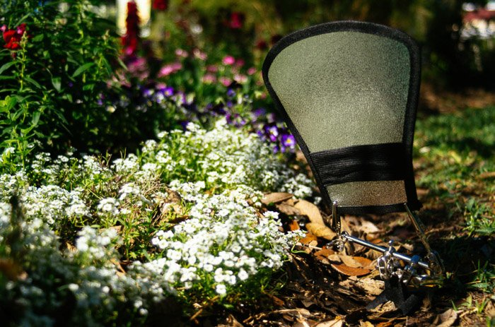 Shot of a reflector among flowers and plants for improved flower photos