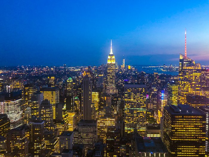 An aerial view of a stunning cityscape at night - photography prices for beginners