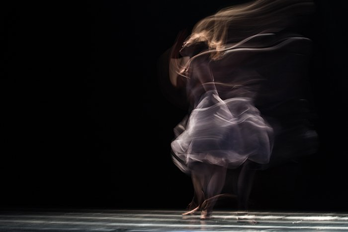 Artistic impressionist photography of a dancer performing onstage
