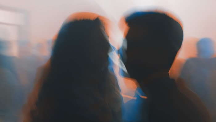 An impressionist style blurred photo of a couple talking
