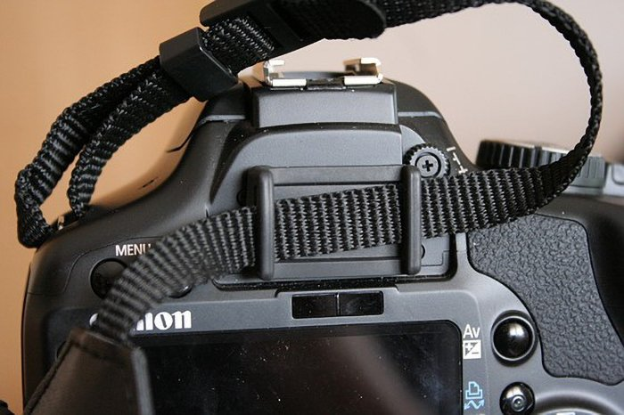 The cover for the optical viewfinder of a Canon DSLR.