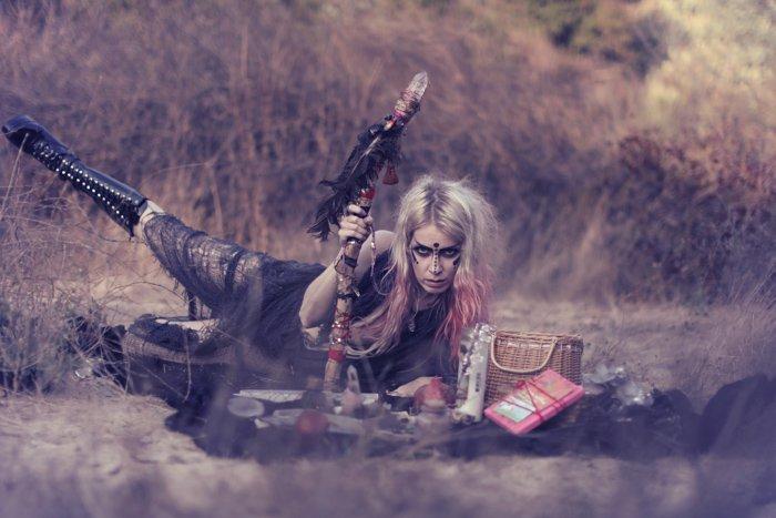 A female model posing outdoors in tribal gear