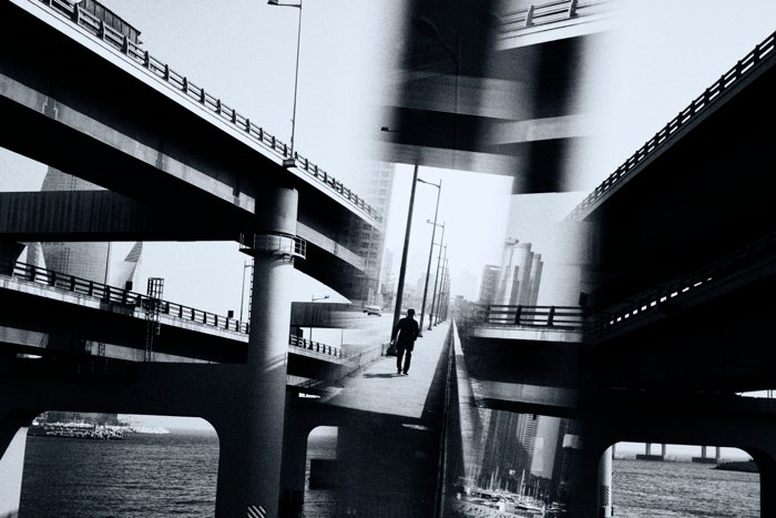 a black and white street photo taken with a prism for creative effect