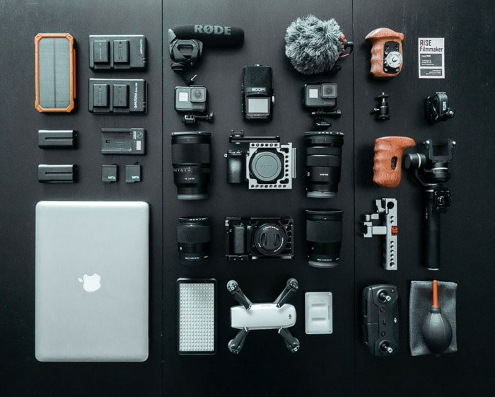 Flat lay photo of various used cameras and camera gear