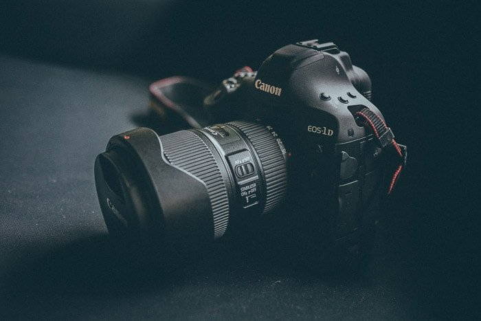 close up of a canon DSLR on black background - best place to sell used camera equipment