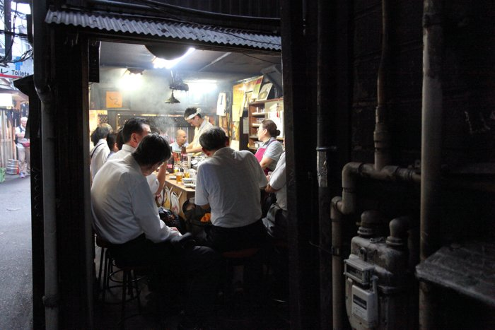Candid street shot of a busy back alley in Tokyo