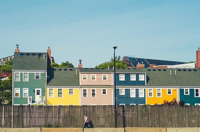 A row of houses painted in complementary colors