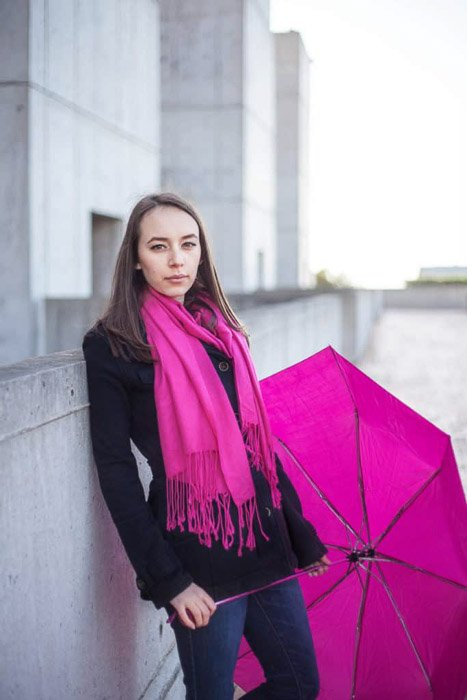 A TFP shoot featuring a female model posing in pink scarf with pink umbrella