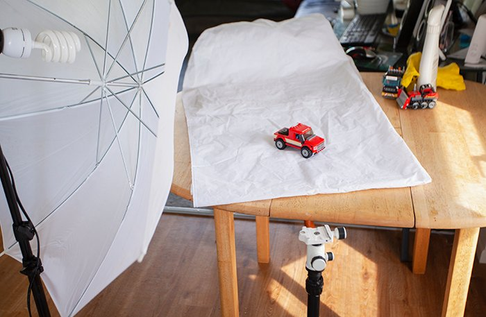 A basic kitchen table set-up for photographing toys at home