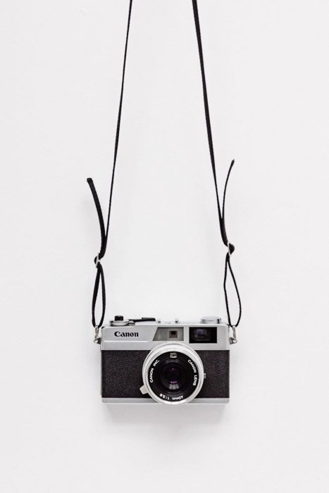 A canon dslr against white background - best camera stores