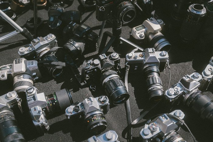 Different types of cameras on a table - best camera stores to buy from