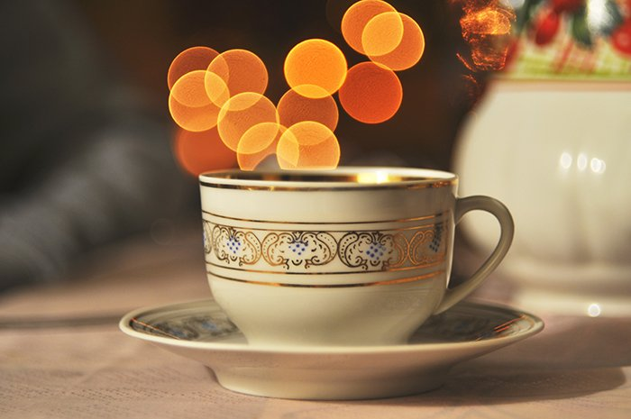 Beautiful Christmas bokeh lights in the background of a coffee cup