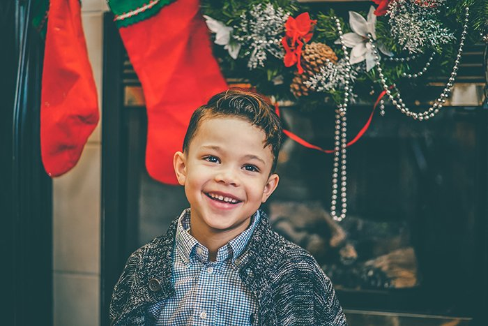 An indoor Christmas portrait of a little boy