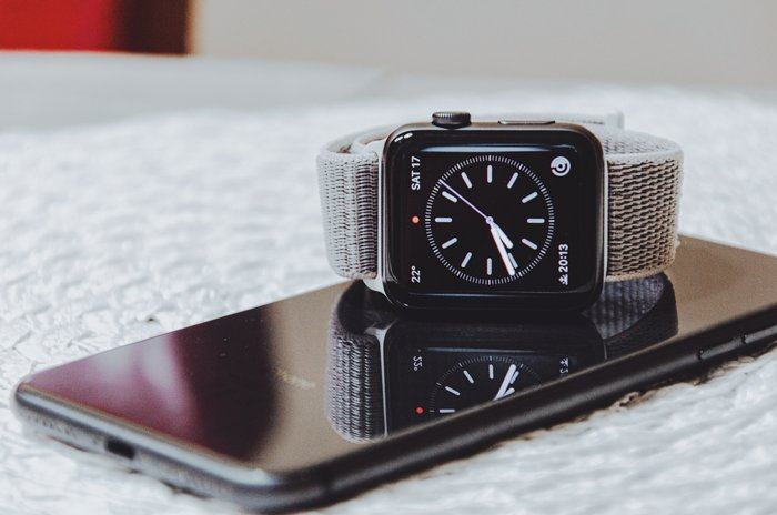 a wristwatch placed on a smartphone screen